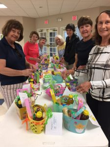 Congregational Care leaders assembling Easter Baskets for shut ins.